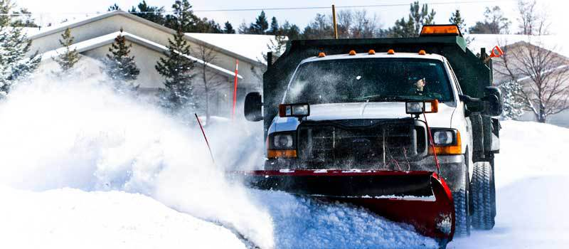 Stop winter from damaging your paint! Do your snow removal with us